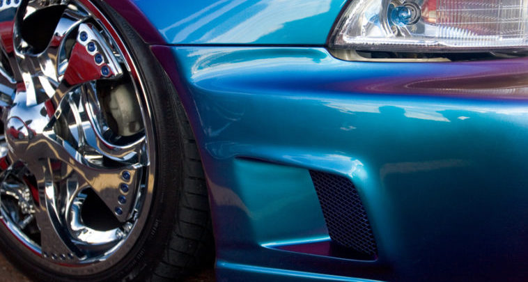 Blue flop paint job on a tricked out car with chrome wheels