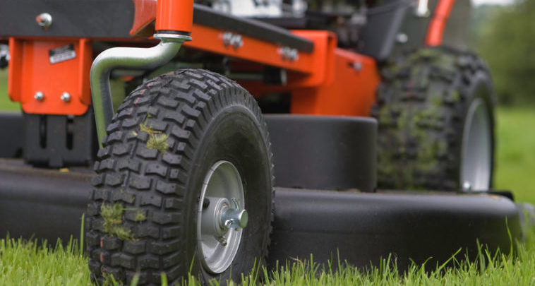 A large mower sits on the lawn.